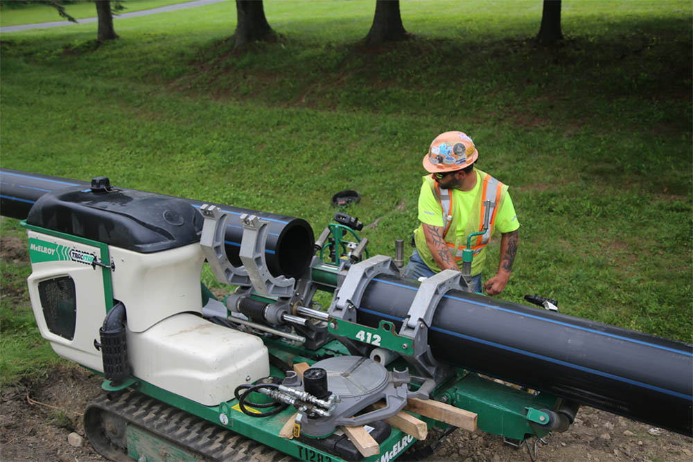 An ISCO team member fusing HDPE pipe