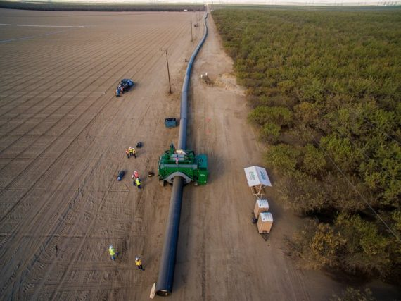 McElroy Talon machine fusing large diameter pipe at an almond farm