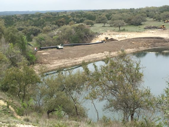 McElroy fusion equipment fusing HDPE pipe fixing a spillway in Wimberly, Texas